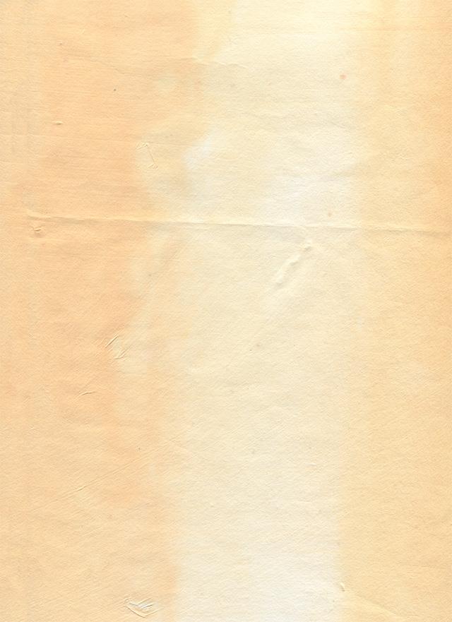色落ちしたオレンジ色の紙のテクスチャ素材
